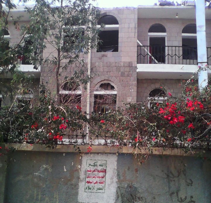 Houthi graffiti appears on the wall of the compound housing theal-Noor Center.