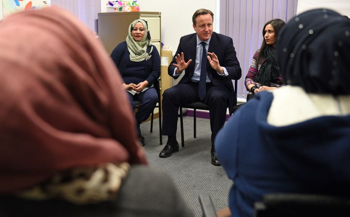U.K. Prime Minister David Cameron speaks with women attending an English language class in Leeds, England. Cameron annou
