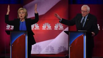 TOPSHOT - Democratic presidential candidates Hillary Clinton (L)  and Bernie Sanders (R) participate in the NBC News -YouTube Democratic Candidates Debate on January 17, 2016 at the Gaillard Center in Charleston, South Carolina.. / AFP / TIMOTHY A. CLARY        (Photo credit should read TIMOTHY A. CLARY/AFP/Getty Images)