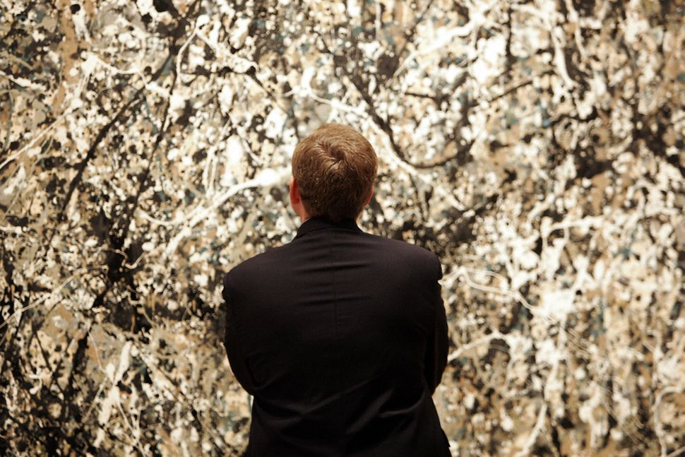 French Culture Minister Renaud Donnedieu de Vabres looks at a painting by Jackson Pollock at the Museum of Modern Art (MOMA)