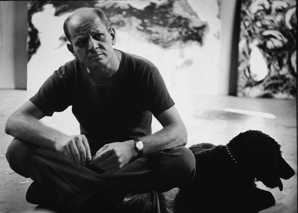 American abstract expressionist painter Jackson Pollock (1912-1956) in his studio at 'The Springs,' East Hampton, New York, A