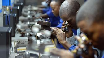 Workers check, cut and polish diamonds at a Diamond cutting and polishing company during the tour by Ghanian President John Dramani Mahama in Gaborone, on March 11, 2015.  AFP PHOTO/MONIRUL BHUIYAN        (Photo credit should read Monirul Bhuiyan/AFP/Getty Images)