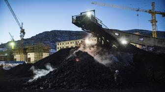 SHANXI, CHINA -NOVEMBER 25: (CHINA, HONG KONG, MACAU, TAIWAN OUT) Coal is piled up as it is sorted at a coal mine on November 25, 2015 in Shanxi, China. A history of heavy dependence on burning coal for energy has made China the source of nearly a third of the world's total carbon dioxide (CO2) emissions, the toxic pollutants widely cited by scientists and environmentalists as the primary cause of global warming. China's government has publicly set 2030 as a deadline to reach the country's emissions peak, and data suggest the country's coal consumption is already in decline.  (Photo by Kevin Frayer/Getty Images)