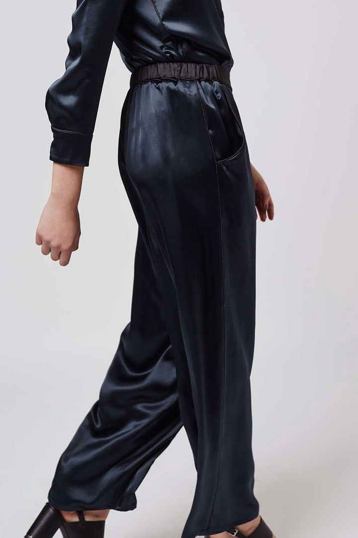 "<i>Boutique Satin Pyjama Style Wide Leg Trousers, <a href=""http://us.topshop.com/en/tsus/product/clothing-70483/pants-70502/satin-pj-wide-leg-5015258?bi=20&amp;ps=20"" target=""_blank"">$210</a></i>"