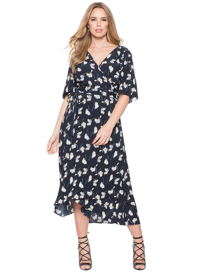 "<i>Eloquii Circle Sleeve Wrap Dress, <a href=""http://www.eloquii.com/circle-sleeve-wrap-dress/1232221.html?cgid=dresses&amp;dwvar_1232221_colorCode=42&amp;start=3&amp;ppid=c3"" target=""_blank"">$110.90</a></i>"