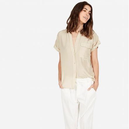 "<i>Everlane The Habotai Silk Short-Sleeve, <a href=""https://www.everlane.com/collections/womens-tops/products/womens-habotai-shortsleeve-ecru"" target=""_blank"">$55</a></i>"