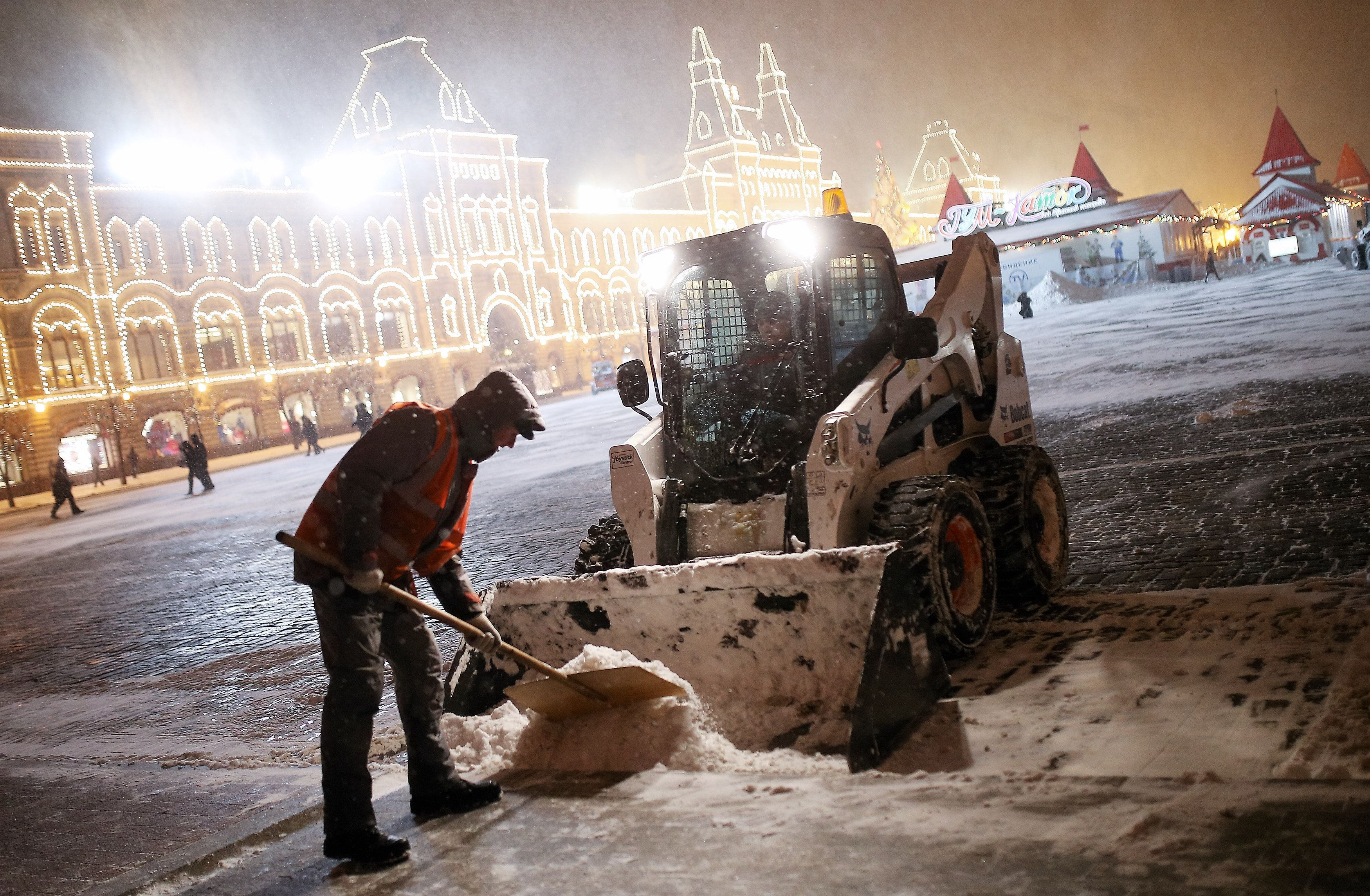 MOSCOW, RUSSIA - JANUARY 12:  Snowplows clean the Red Square on January 12, 2016 in Moscow, Russia. A strong atmospheric front swept through Moscow bringing a large amount of snow to the city. (Photo by Kristina Kormilitsyna/Kommersant Photo via Getty Images)