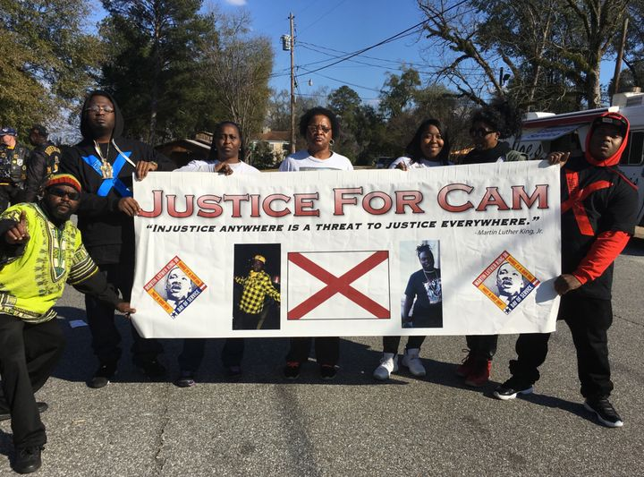 Jackie Massey (third from left) and supporters marched for justice during the Martin Luther King Jr. Day parade in Eufau