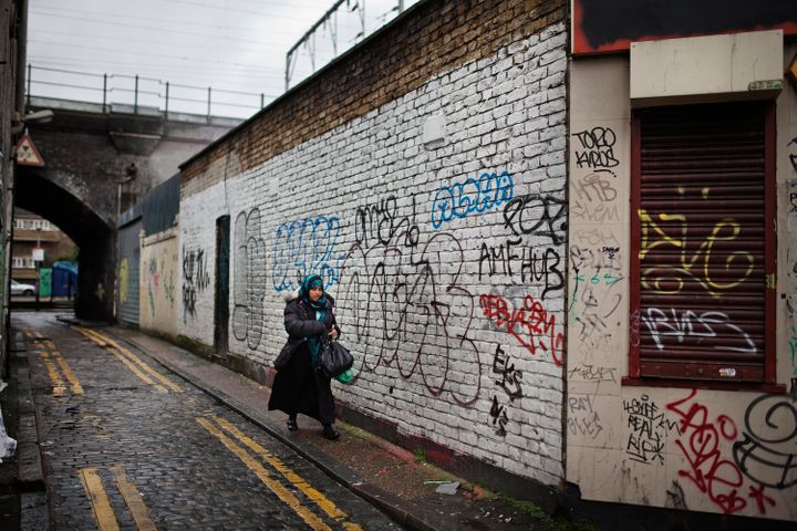 A woman walks in an alley in Bethnal Green, a Muslim-dominated neighborhood in East London. Cameron told BBC R