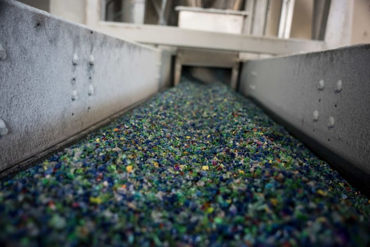 A picture taken on November 3, 2015 shows shredded plastic waste collected in the sea by fishermen on a conveyer belt at a pl
