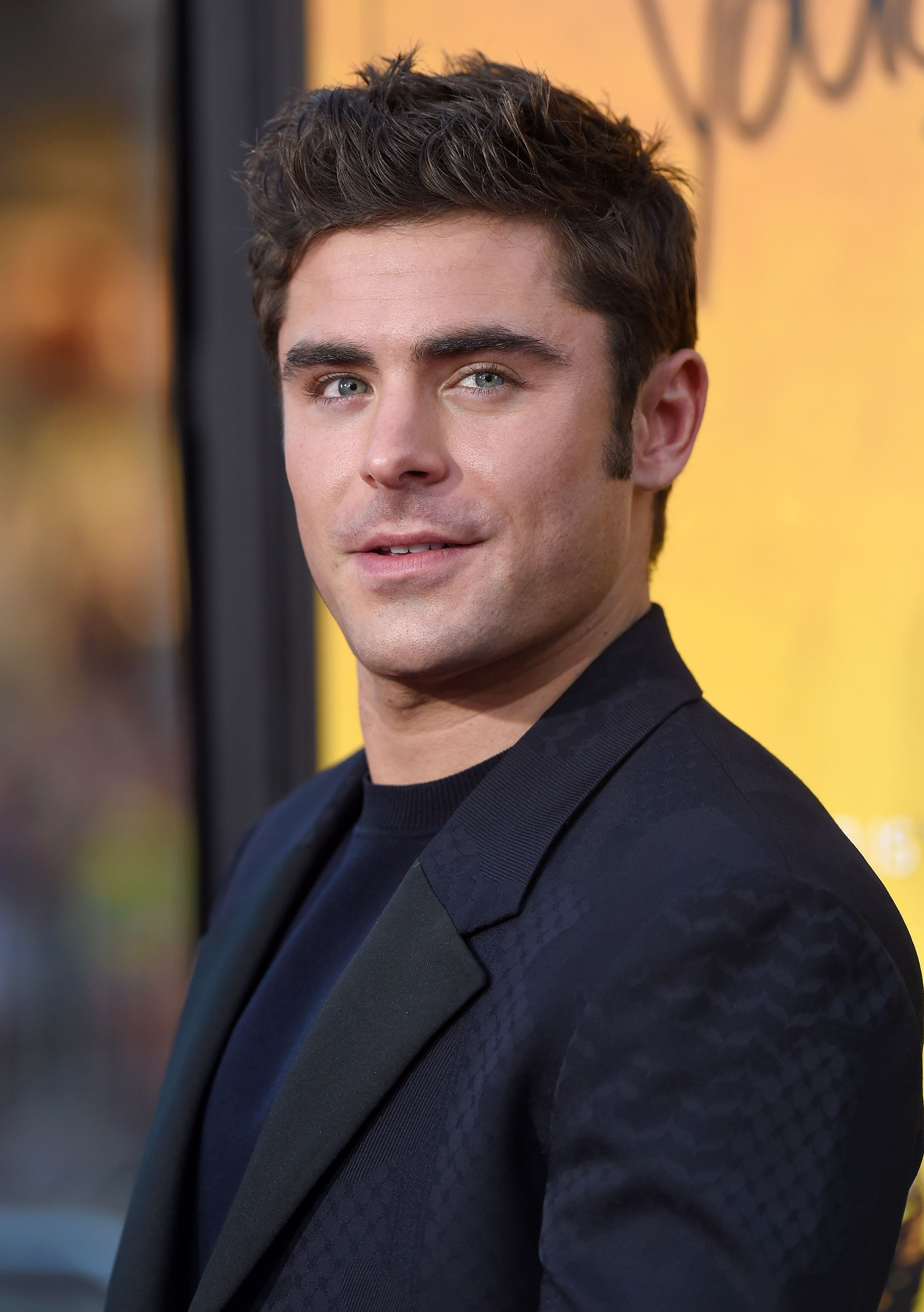 HOLLYWOOD, CA - AUGUST 20:  Actor Zac Efron arrives at the premiere of Warner Bros. Pictures' 'We Are Your Friends' at TCL Chinese Theatre on August 20, 2015 in Hollywood, California.  (Photo by Axelle/Bauer-Griffin/FilmMagic)