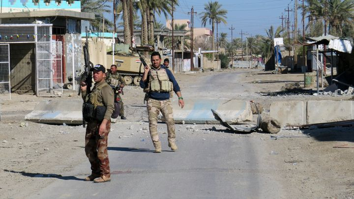 Iraqi security forces secure a street in Ramadi, Iraq. The U.N. report said the majority of those being held are women and ch