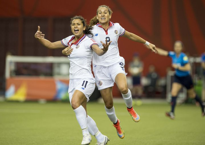 Raquel Rodriguez (left) celebrates after scoring Costa Rica's first-ever Women's World Cup goal during a match against Spain