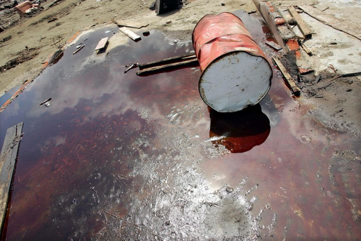 A barrel lies in a pool of oil at a damaged petroleum plant on Jan. 15, 2005, in Indonesia, after a 9.0 earthq