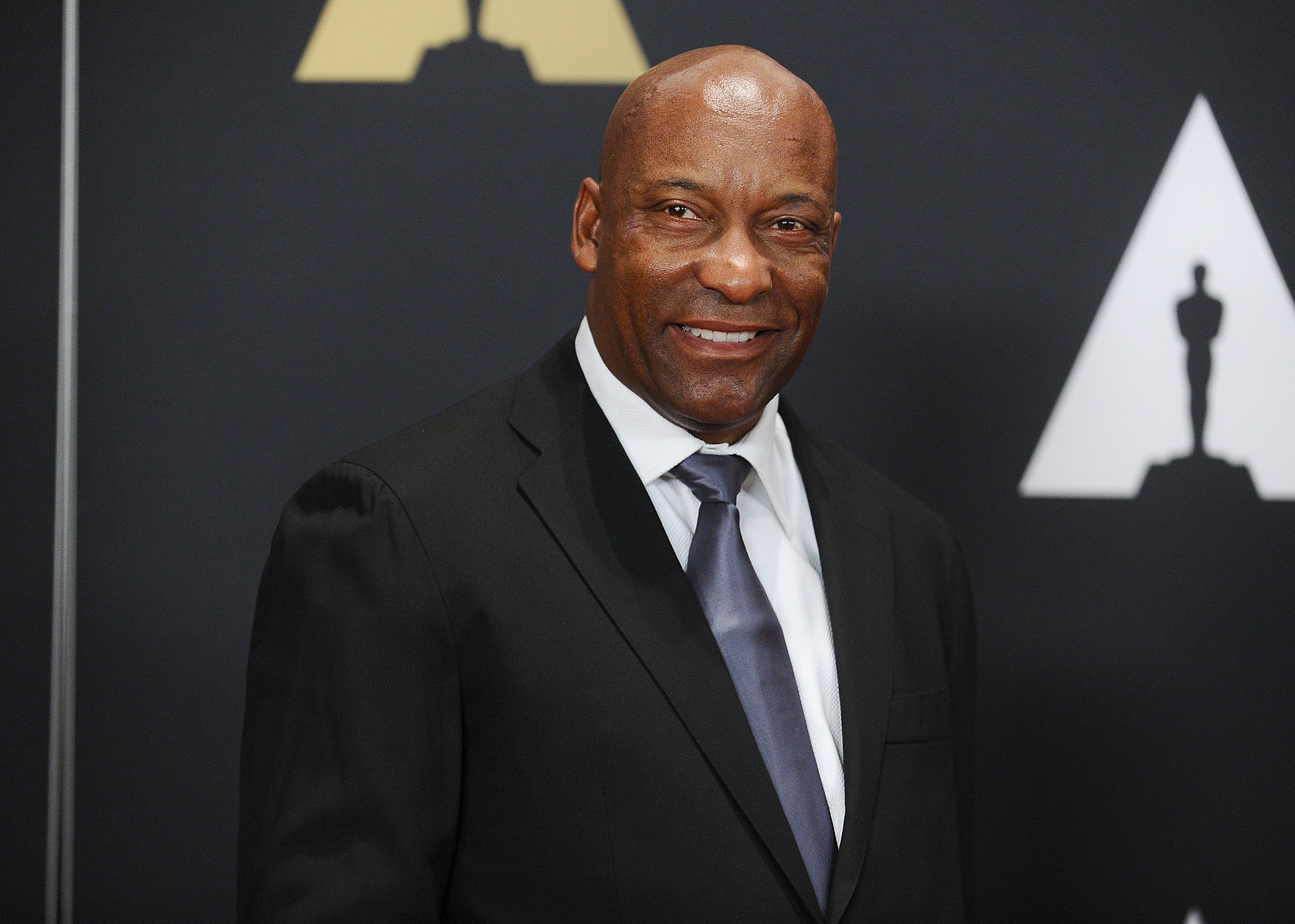 HOLLYWOOD, CA - NOVEMBER 14:  Director John Singleton attends the 7th annual Governors Awards at The Ray Dolby Ballroom at Hollywood & Highland Center on November 14, 2015 in Hollywood, California.  (Photo by Jason LaVeris/FilmMagic)