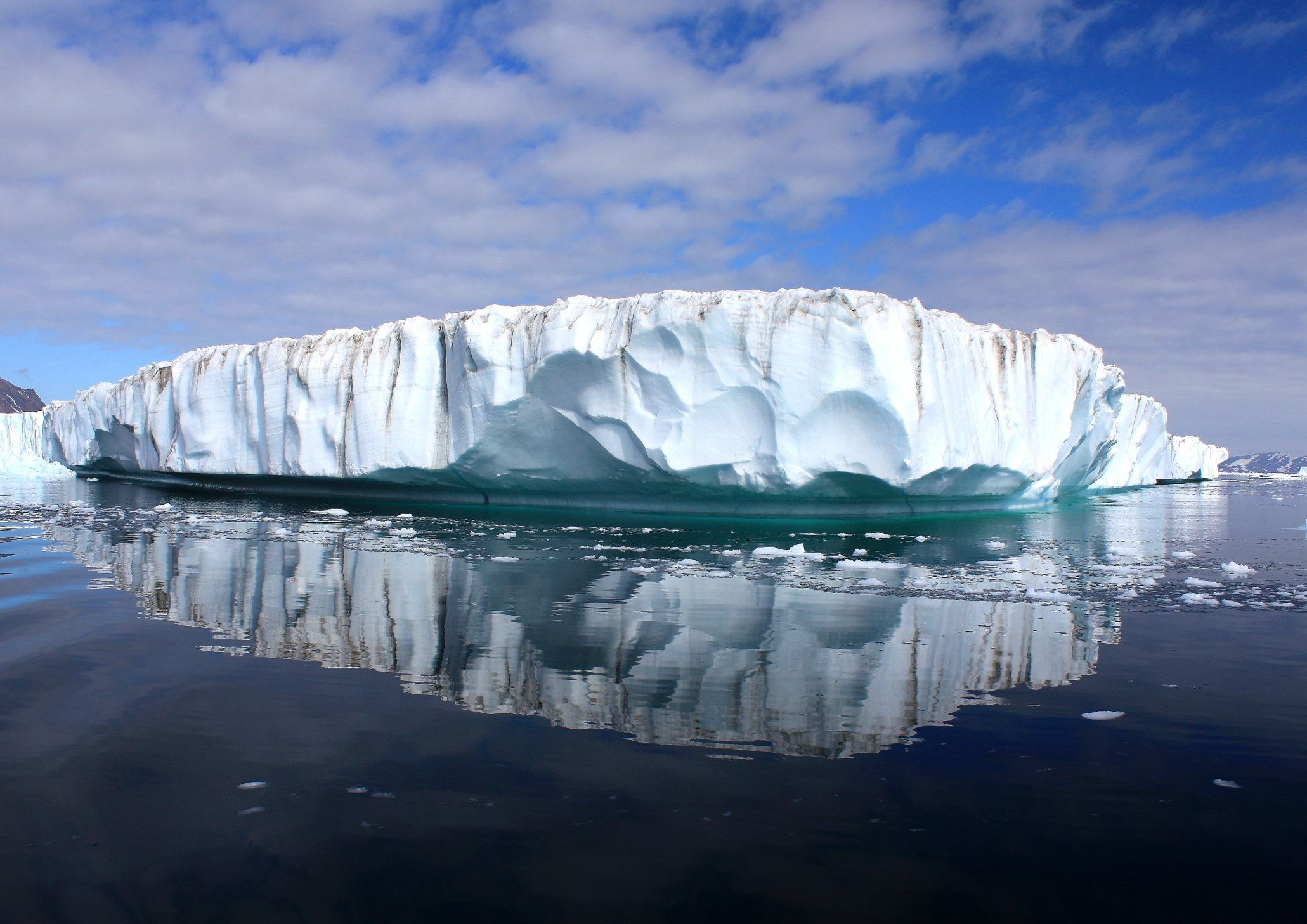 Clouds float above the east Greenland ice sheet and glaciers.