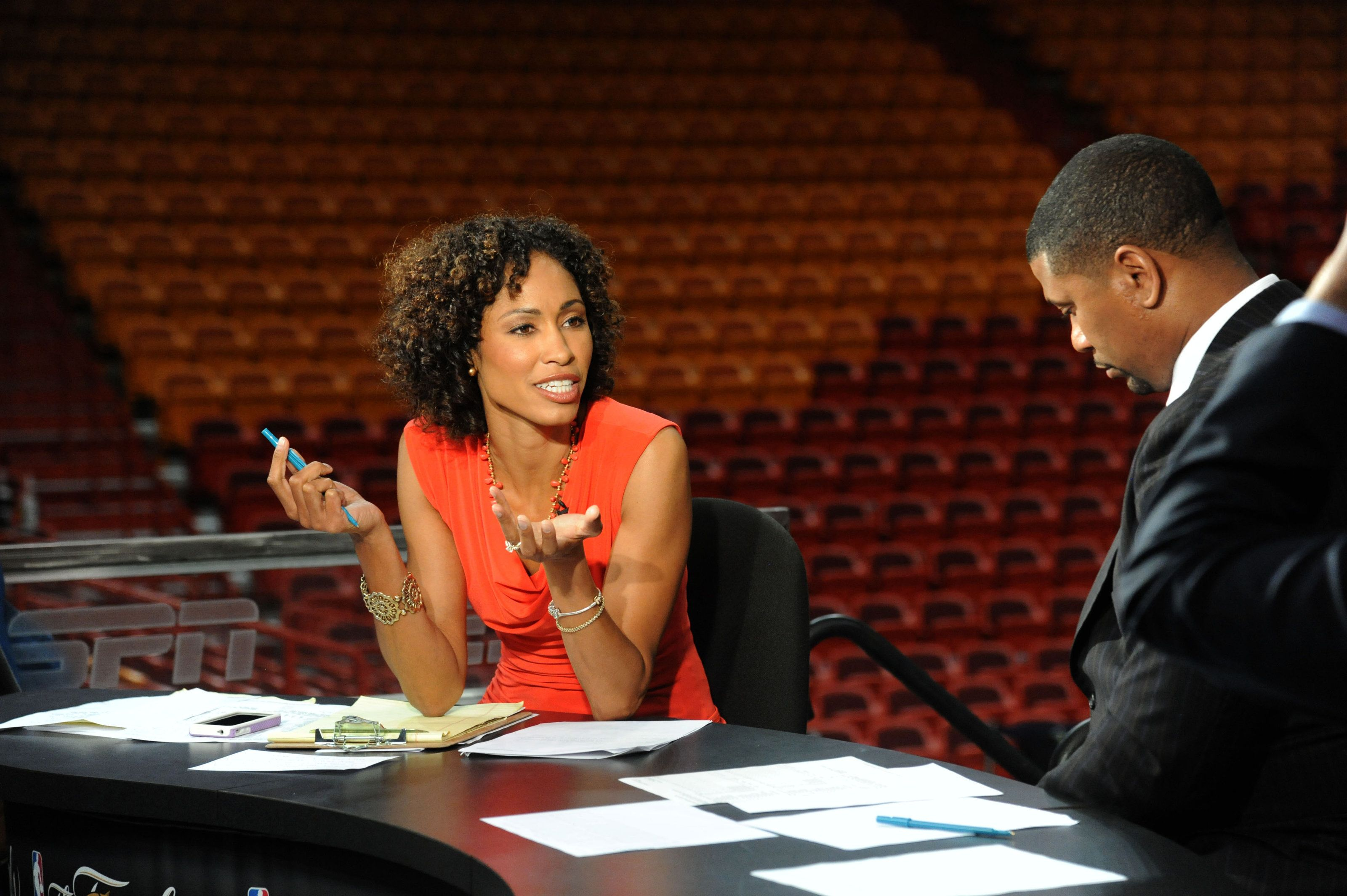 Steele speaks with Jalen Rose while preparing for a 2012 NBA Finals game at American Airlines Arena in Miami, Florida.