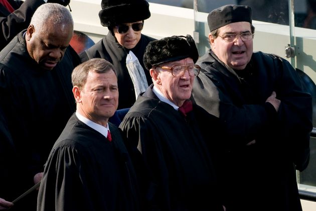 Stevens (center) attends the inauguration of President Barack Obama in 2009. Standing around him (clockwise...