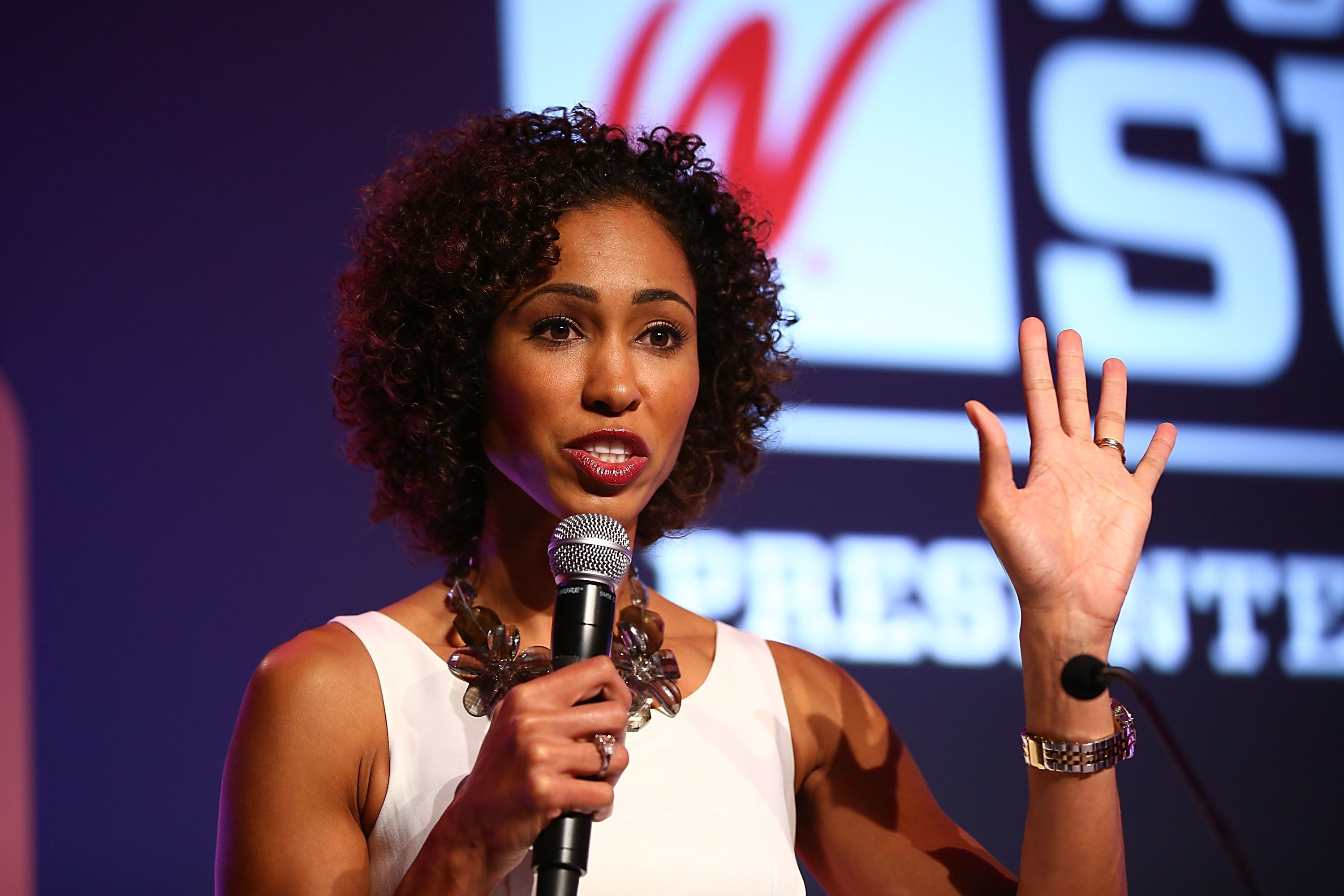 DANA POINT, CA - OCTOBER 09:  Sage Steele speaks onstage at the 2013 espnW: Women + Sports Summit at St. Regis Monarch Beach Resort on October 9, 2013 in Dana Point, California.  (Photo by Joe Scarnici/Getty Images)