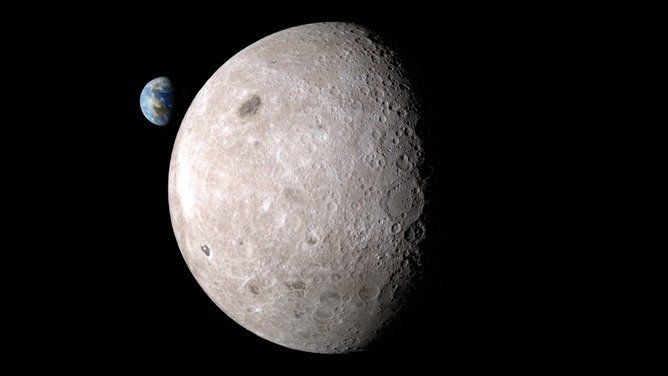Far side of the moon with Earth in the background.