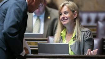 Rep. Mary Dye, right, shares a word on the House Floor.
