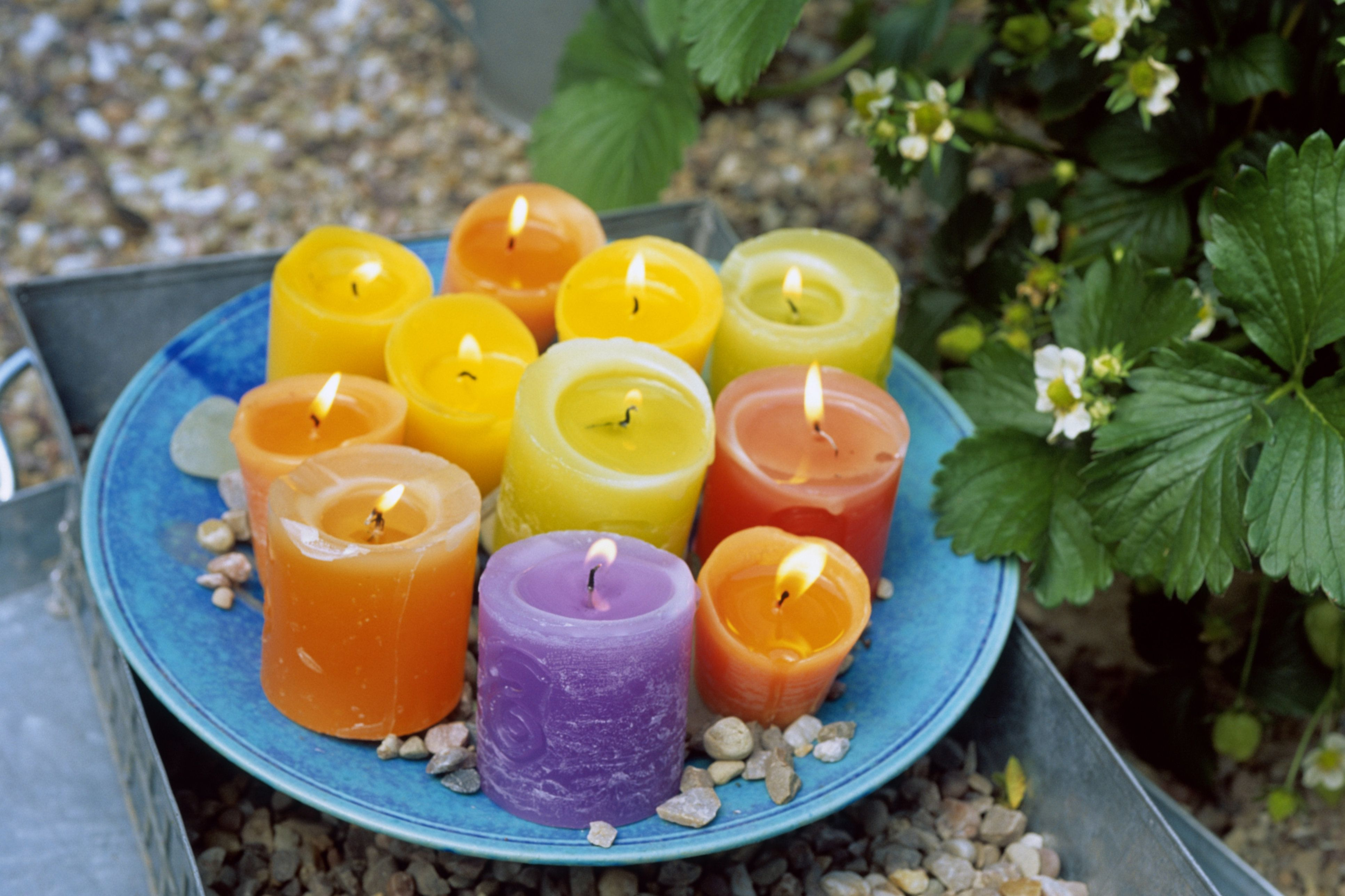 bright scented candles on blue plate different versions under this number