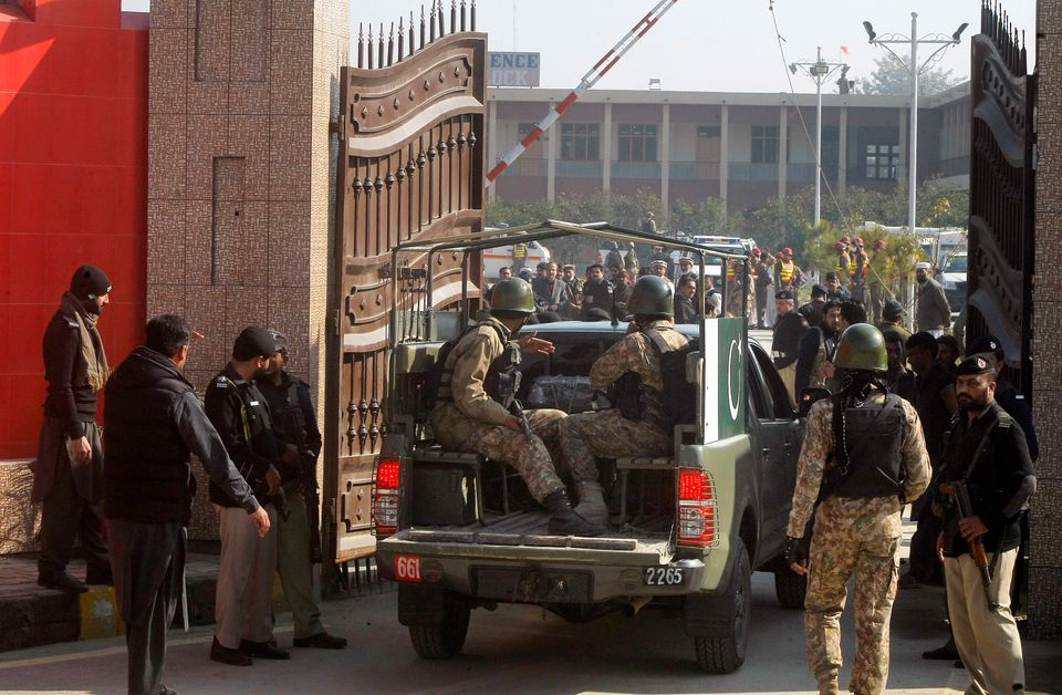 Troops enter the Bacha Khan University following a deadly Taliban militant attack in Bacha Khan University in Charsadda, Paki