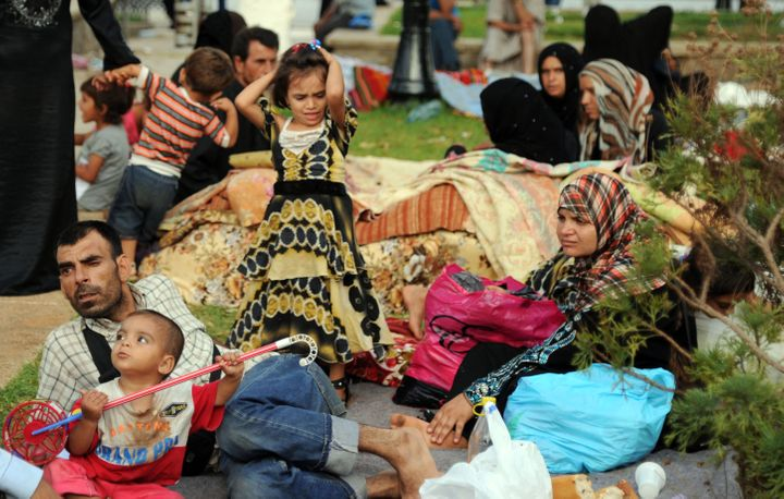 Syrians fleeing the conflict in their home country gather in a garden in Port Said Square in Algiers on July 28, 2012.