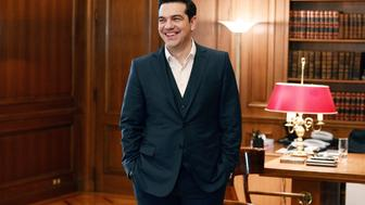 Greek Prime minister Alexis Tsipras smiles before a meeting with newly elected president of the New Democracy party, in his office in Athens on January 19, 2016. / AFP / LOUISA GOULIAMAKI        (Photo credit should read LOUISA GOULIAMAKI/AFP/Getty Images)