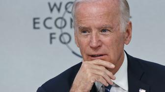 """US Vice-President Joe Biden speaks during a panel """"Cancer Moonshot: A Call to Action"""" during the World Economic Forum in Davos, Switzerland, Tuesday Jan. 19, 2016. The world's political and business elite are being urged to do more than pay lip service to growing inequalities around the world as they head off for this week's World Economic Forum in the Swiss ski resort of Davos. (AP Photo/Michel Euler)"""