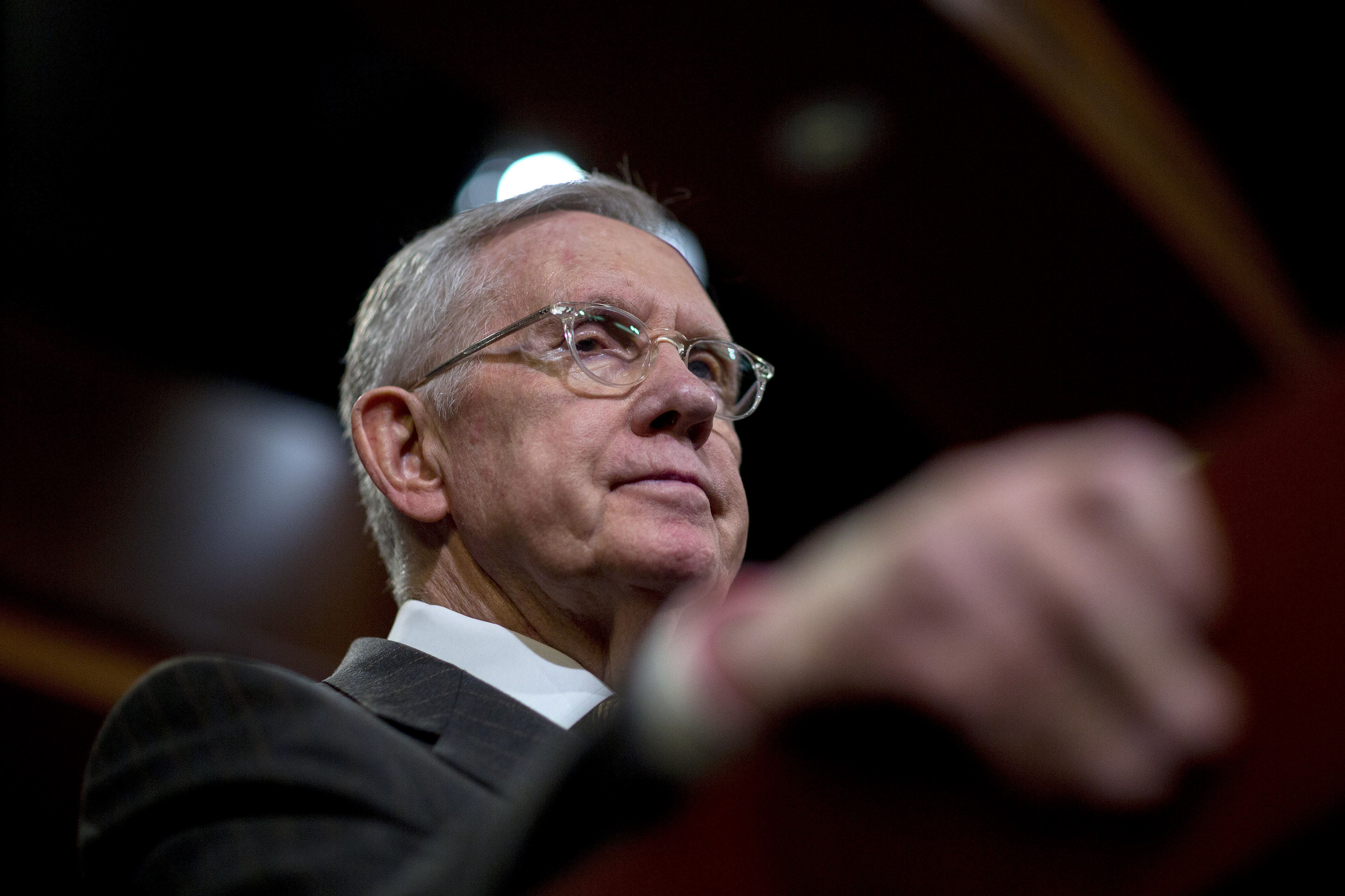 Senate Minority Leader Harry Reid, a Democrat from Nevada, listens to a question during a news conference at the U.S. Capitol in Washington, D.C., U.S., on Thursday, Nov. 19, 2015. Senate Democrats announced a new push to ensure that Islamic State terrorists are not able to slip into the United States through the Visa Waiver Program. Photographer: Andrew Harrer/Bloomberg via Getty Images