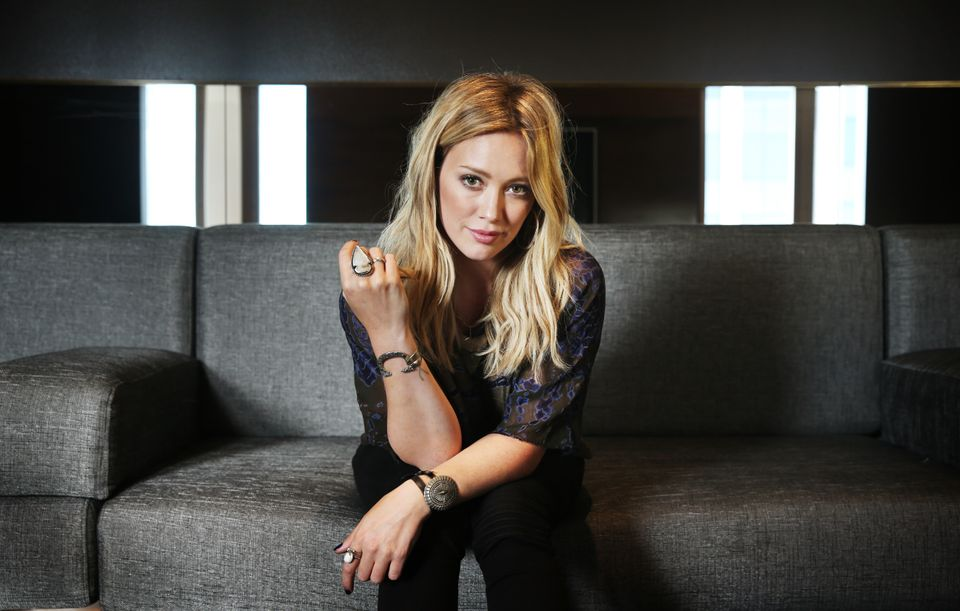SYDNEY, AUSTRALIA - SEPTEMBER 9: (EUROPE AND AUSTRALASIA OUT) American singer Hilary Duff poses during a photo shoot at the I