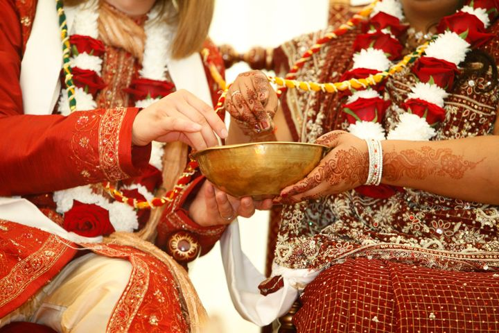 A couple participates in a Hindu wedding ceremony. Interfaith marriages are becoming increasingly common in the United States