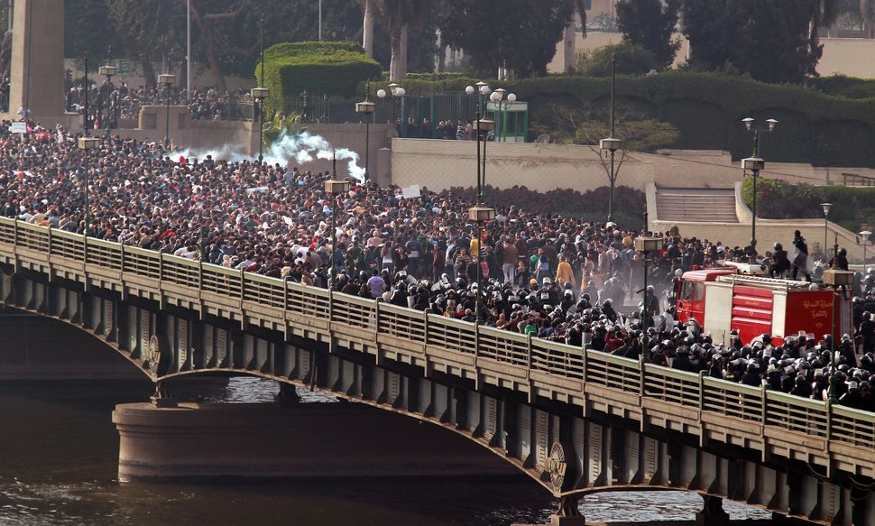 Riot police and protesters clash on the Qasr al-Nir bridge, on Jan. 28, 2011. Fahmy witnessed the police give way to the