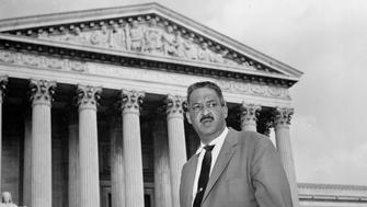 FILE - This Aug. 22, 1958 file photo shows Thurgood Marshall outside the Supreme Court in Washington. Saturday marks the 60th anniversary of the landmark Brown v. Board of Education decision. Many inequities in education still exist for black students and for Hispanics, a population that has grown exponentially since the 1954 ruling. Marshall, the head of the NAACP's legal arm who argued part of the case, went on to become the Supreme Court's first African-American justice in 1967. (AP Photo, File)