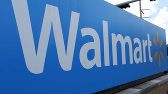MIAMI, FL - AUGUST 18:  A Walmart sign is seen on August 18, 2015 in Miami, Florida. Walmart announced today that earnings fell in the second quarter due to currency fluctuations and the retailer's investment in employee wages and training.  (Photo by Joe Raedle/Getty Images)