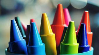 A pot of colorful crayons.