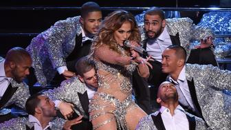 LAS VEGAS, NV - JANUARY 20:  Singer/actress Jennifer Lopez (C) performs with dancers during the launch of her residency 'JENNIFER LOPEZ: ALL I HAVE' at The Axis at Planet Hollywood Resort & Casino on January 20, 2016 in  Las Vegas, Nevada.  (Photo by Ethan Miller/Getty Images)