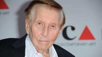 FILE - In this April 20, 2013 file photo, Sumner Redstone arrives at the 2013 MOCA Gala celebrating the opening of the Urs Fischer exhibition at MOCA, in Los Angeles. Attorneys for Redstone and the media mogul's former companion, Manuela Herzer, are locked in a court fight over control of the 92-year-old billionaire's medical care. Herzer contends in court documents filed Wednesday, Nov. 25, 2015, that Redstone is in frail health and lacks the capacity to make decisions, but Redstone's attorneys say those characterizations are lies and he remains in good spirits and able to make informed decisions. (Photo by Richard Shotwell/Invision/AP, File)