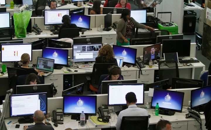 Al Jazeera America editorial newsroom staff prepare for their first broadcast on Tuesday, Aug. 20, 2013 in New York.