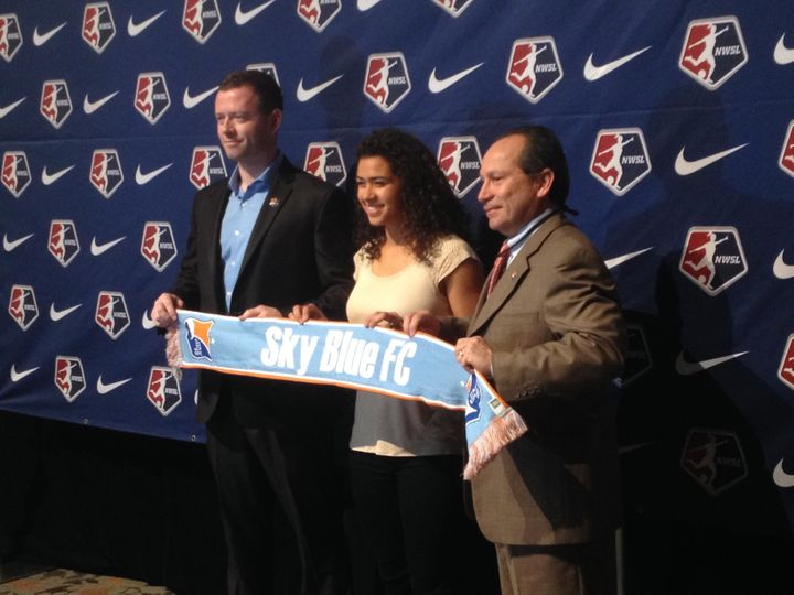 Raquel Rodriguez poses with Sky Blue FC team officials after the team made her the second overall selection in the NWSL draft