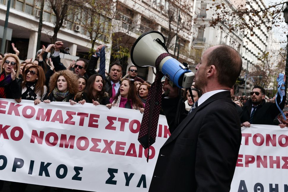 Protesters chant slogans in Athens.