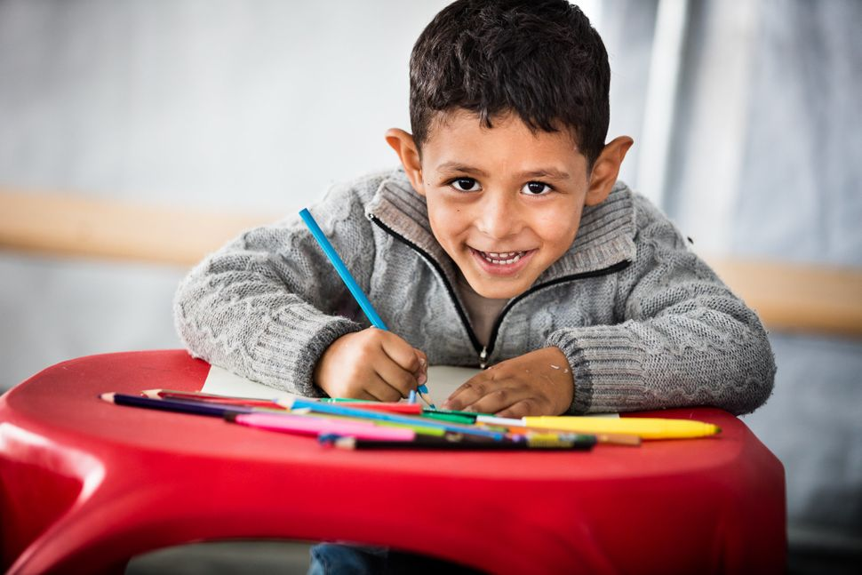 "UNICEF tent in Geveglija, Macedonia (FYROM)<br><br><i>""With a smile like this, it'€™s easy to see that this Syrian child knew"