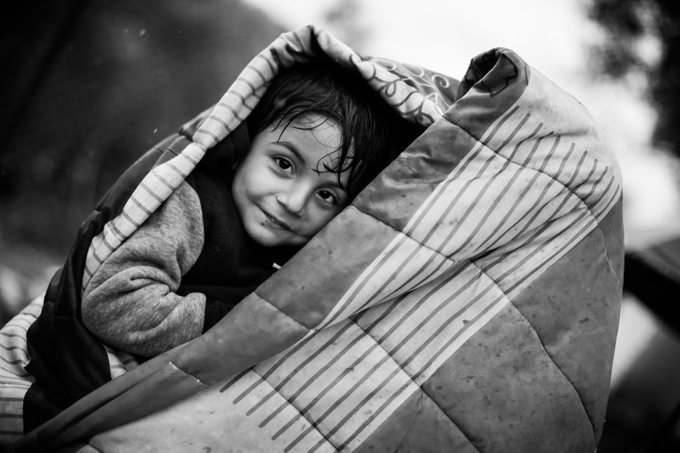 "Moria, Lesbos Island, Greece<br><br><i>""This boy had not given up on hope and his eyes were still shining and his smile radia"