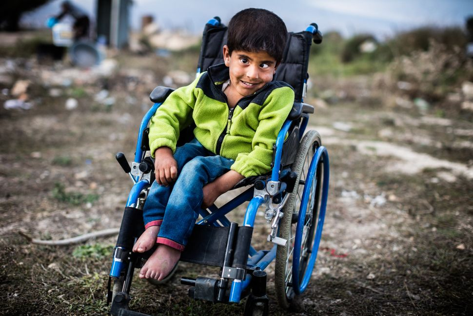 "Syrian boy in Bekaa Valley, Lebanon<br><br><i>""This smile broke my heart and always will. I know that whatever happens in my"