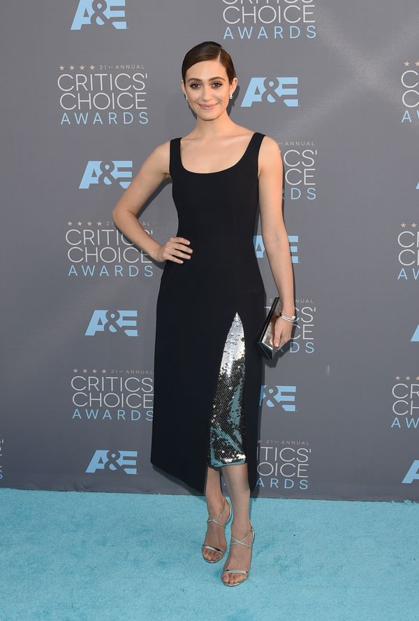 <strong>Emmy Rossum in Dior:</strong> From the back, this might look like another plain black dress, but the metallic slit is