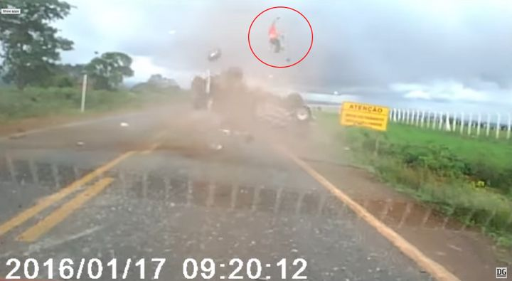 A man is seen being ejected out of a car like a rocket in Brazil as the rolling vehicle flies off the road.