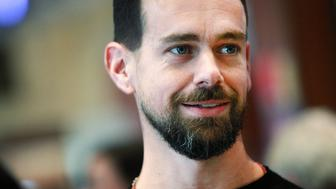 Jack Dorsey, chief executive officer of Square Inc., tours the floor of the New York Stock Exchange (NYSE) in New York, U.S., on Thursday, Nov. 19, 2015. Square Inc. jumped more than 60 percent after the mobile payments company priced its initial public offering low enough to entice skeptics as well as bulls who are confident in its growth prospects. Photographer: Yana Paskova/Bloomberg via Getty Images
