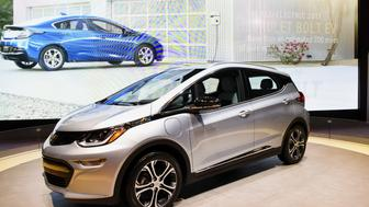 The General Motors Co. (GM) Chevrolet Bolt electric vehicle (EV) is displayed during the 2016 Consumer Electronics Show (CES) in Las Vegas, Nevada, U.S., on Thursday, Jan. 7, 2016. CES is expected to bring a range of announcements from major names in tech showcasing new developments in virtual reality, self-driving cars, drones, wearables, and the Internet of Things. Photographer: David Paul Morris/Bloomberg via Getty Images
