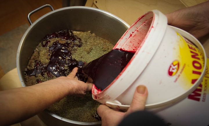 Blood is poured during the preparation of Estonian blood sausage in Tallinn, Estonia, on December 15, 2012.